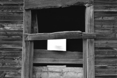 Boarded Window with Square of Light